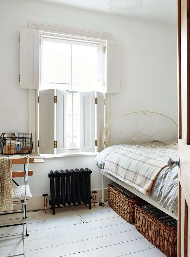 London stylist Sara Emsliefitted all of the windows inher tiny Victorian in Richmond outside London with wooden shutters in &#8