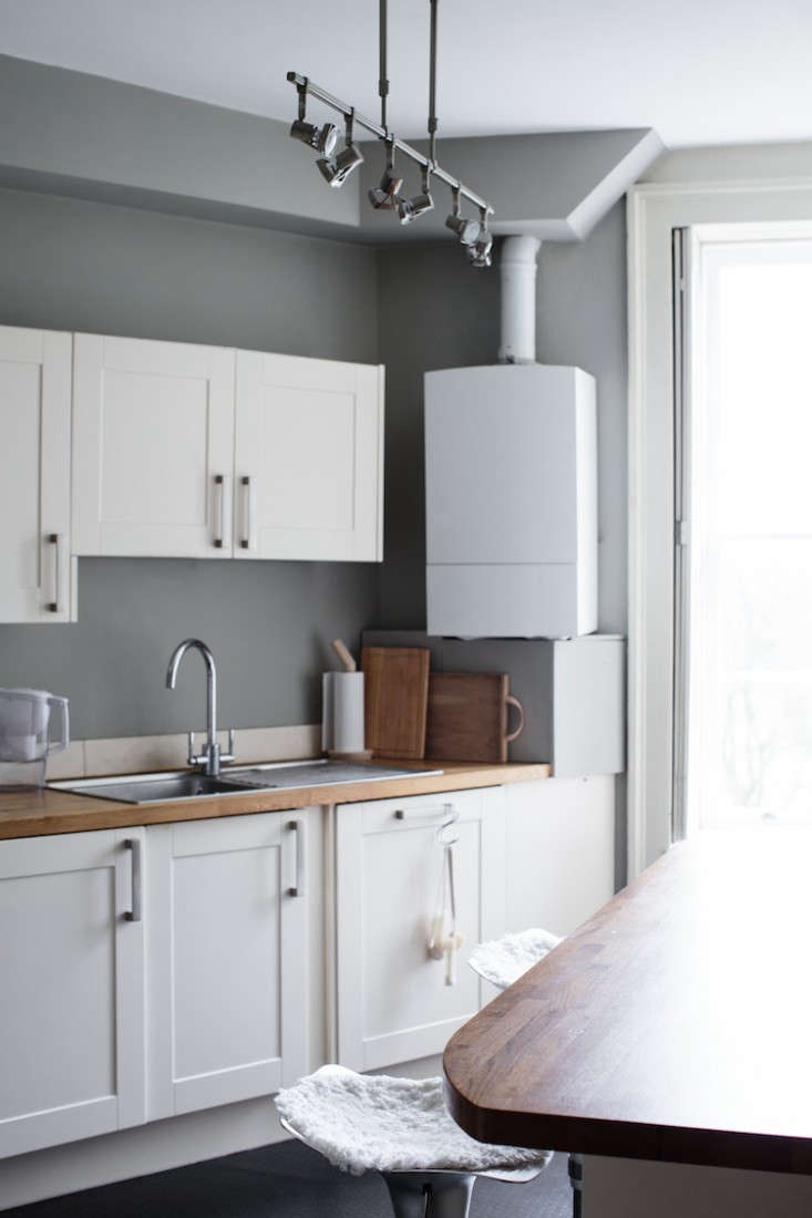 the gray and white kitchen overlooks a golf course; park says the light is espe 15