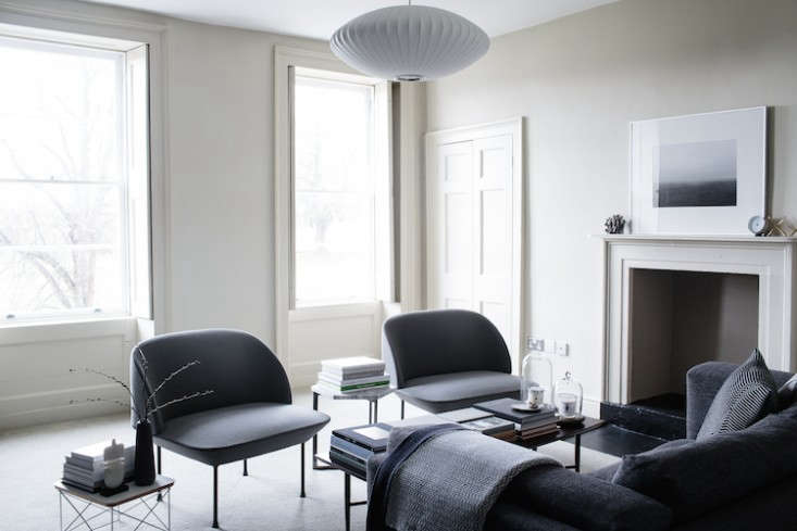 in the living room, park adheres to a black, gray, and white palette. the pair  11