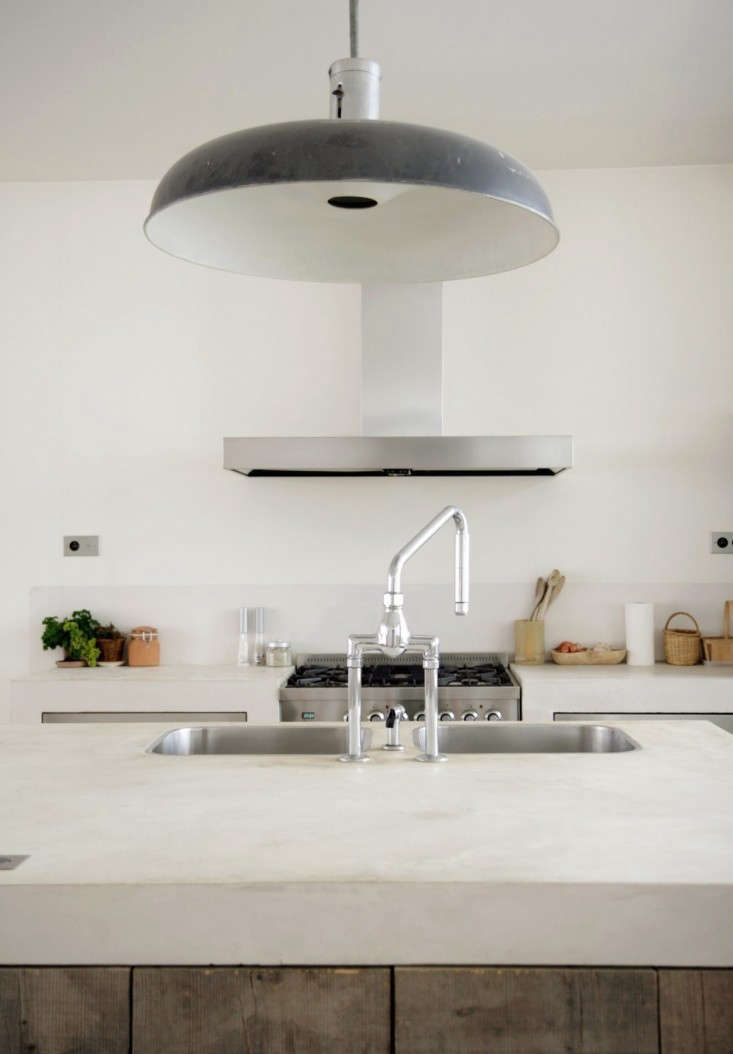 Two separate sink basins share a faucet in a Paris kitchen; see Designer Visit: Paris Meets Provence.