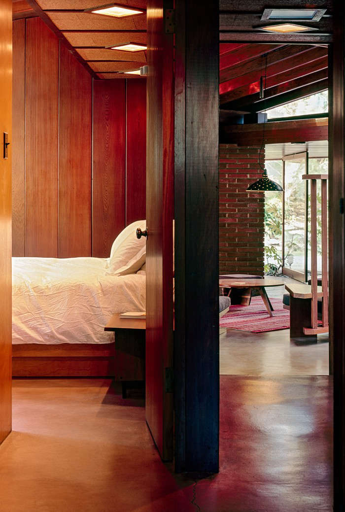 The redwood paneling runs throughout the house, including in the bedrooms.