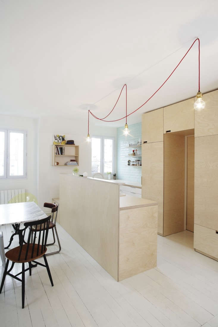 A small-space plywood kitchen benefits from unobtrusive cutout cabinet pulls. See more space-saving ideas in Kitchen of the Week: A Compact Family Kitchen in Paris.