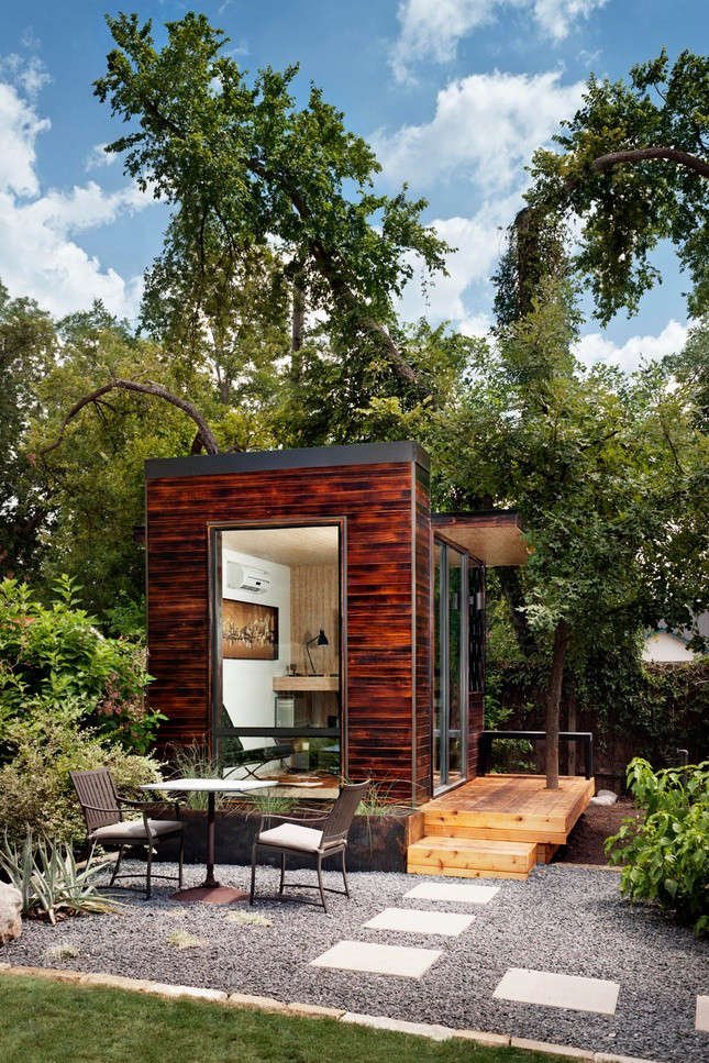 A modular studio (for use as a home office, guest room, or play space) made from shou sugi ban siding by Sett Studio of Austin, Texas.