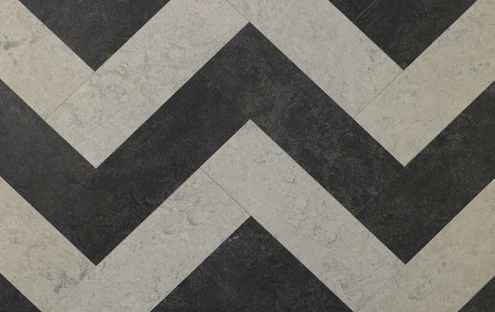 Brown-and-white marbled zigzag linoleum fromSinclair Till.
