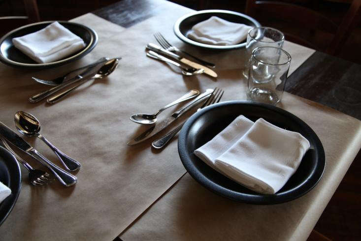 Traditional flatware and understated dinnerware, in black.
