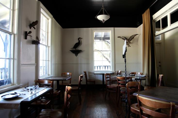 Black ceilings and ornithological taxidermy in the front dining room.