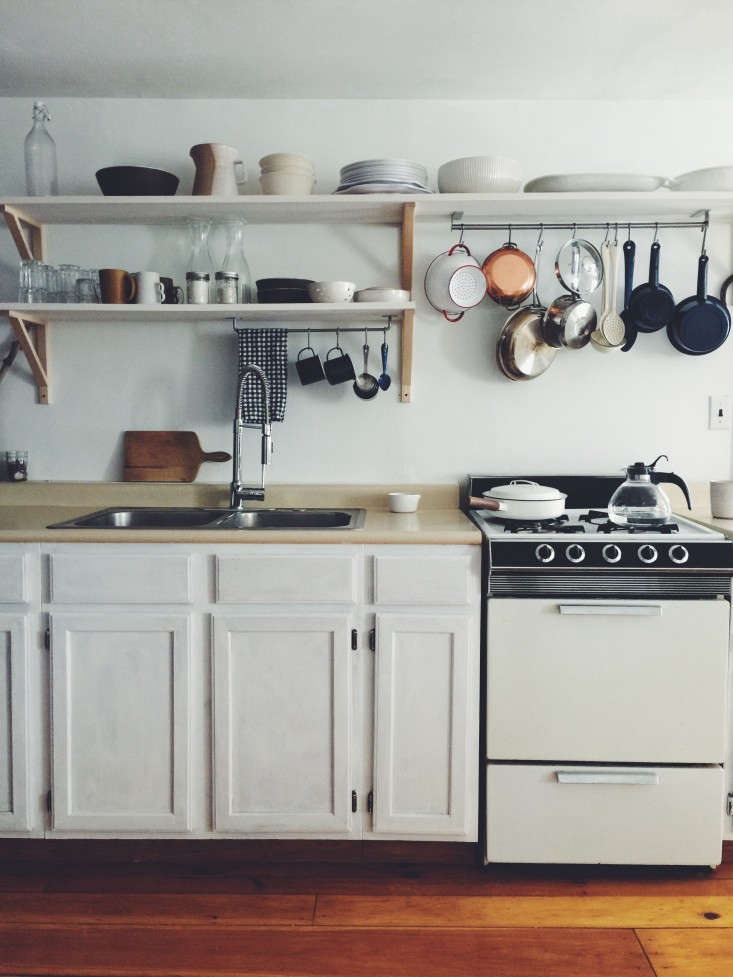 Ultimate Budget Storage 10 Kitchens with Ikeas Grundtal Rail System A Grundtal rail hangs on the underside of a shelf in a Brooklyn kitchen fromBefore & After: The \$350 DIY Kitchen Overhaul in Two Weekends.