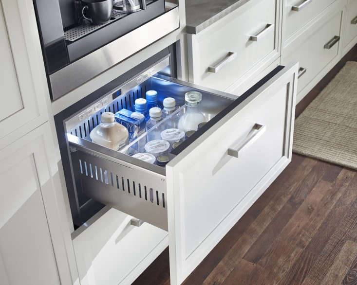 True drawers with overlay panels situated under a coffee station.