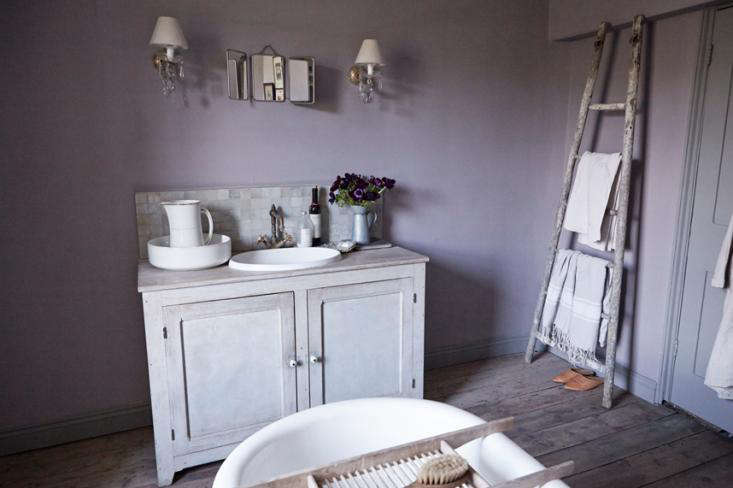 The bathroom sink unit is made from a cupboard found at an antiques market; Twig inserted a sink and reclaimed kitchen tap.