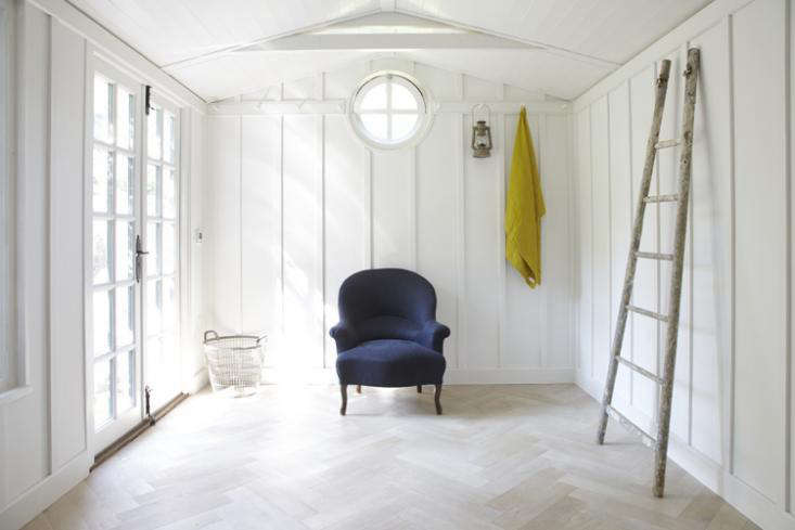 a rustic ladder provides clothes storage opportunities; strips of shaker hooks  10