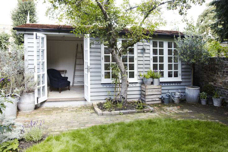the south facing summerhouse maximizes light with a wall of windows and patio d 9