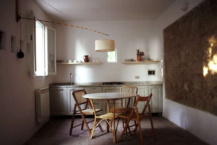 Also atVilla Lena: An apartment kitchenfeatures cabinets painted in dusty sage. SeeVilla Lena: A New Creative Hub (and Hotel) in Tuscany.