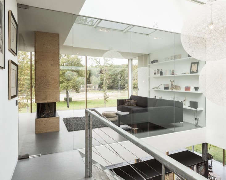 on the second floor living area, a thick plywood wall houses a fireplace and al 19