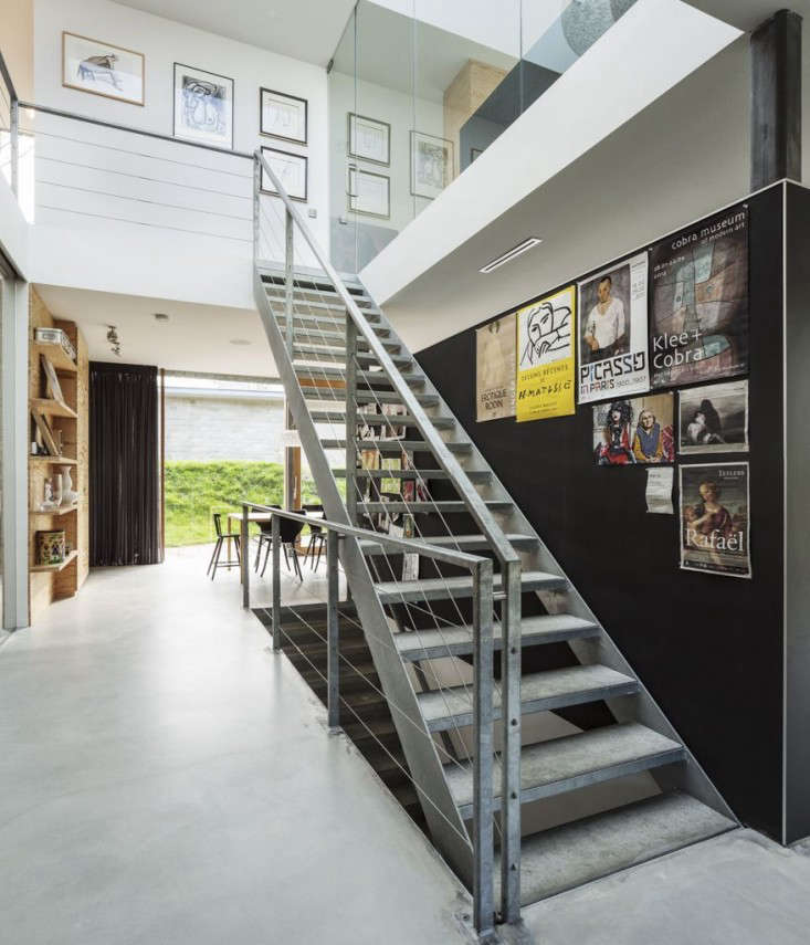 industrial galvanized metal stairs work well with the polished concrete floors. 17