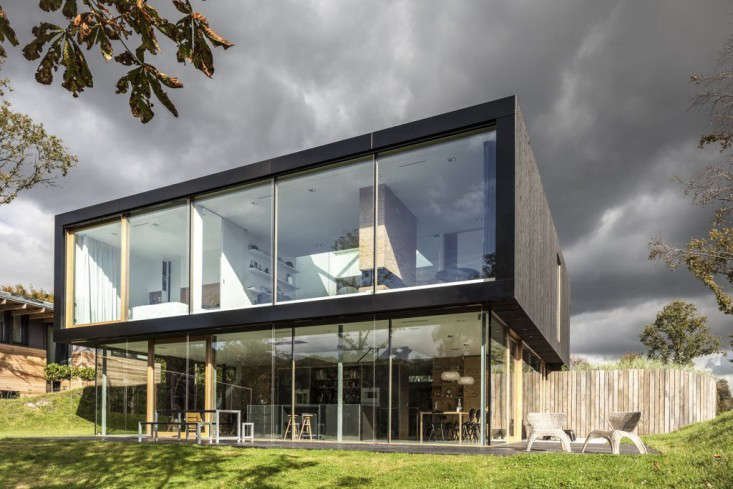 built into the slope of a hill, both floors are glazed to enjoy the views of th 9