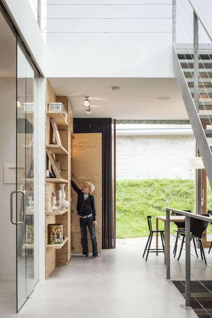 on the ground floor, open and closed storage made from veneered plywood forms a 12