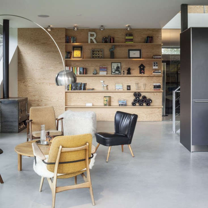 the plywood wall extends out and serves as a backdrop for the living area. 13