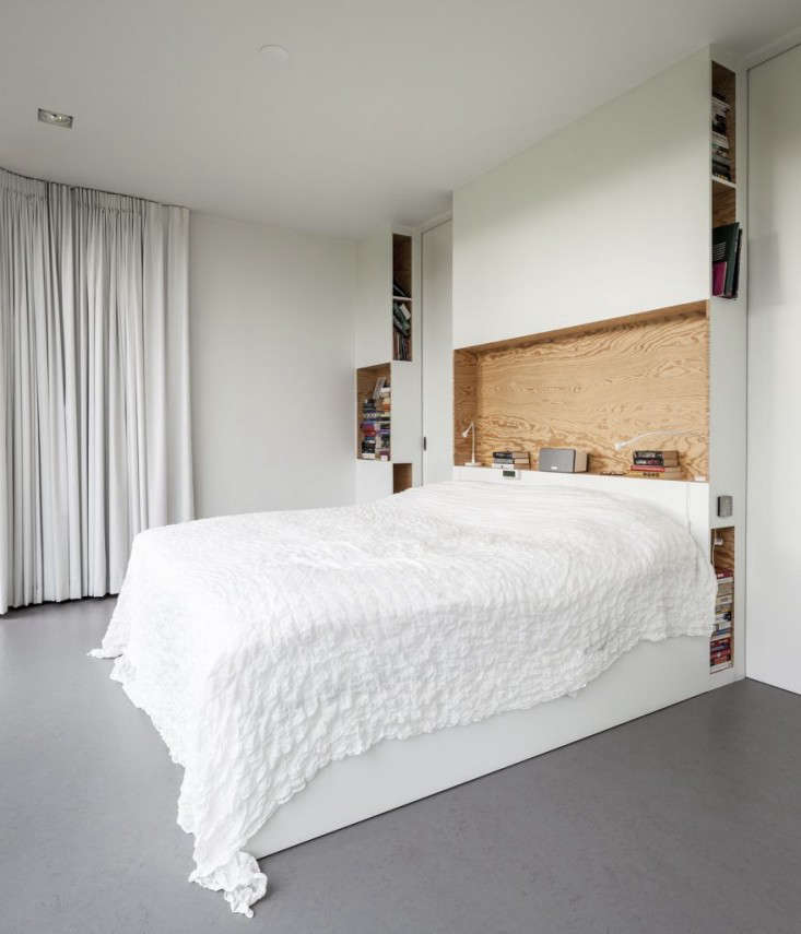 in the master bedroom, the bed is integrated into the headboard and the thickne 22