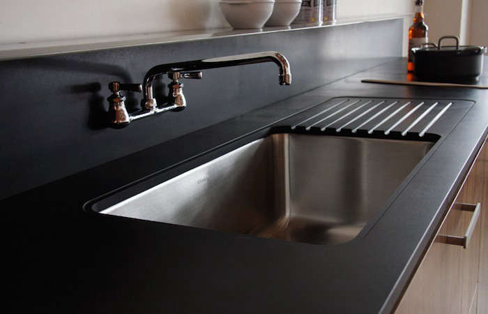 Remodeling 101 Paper Composite Countertops for the Kitchen Paper based composite slabs have the look and feel of soft stone. Available in thicknesses ranging from a quarter inch to three inches, this countertop material can be easily shaped to create, among other things, drainboards. Photograph via Seattle kitchen companyViola Park(a subdivision of Henrybuilt).