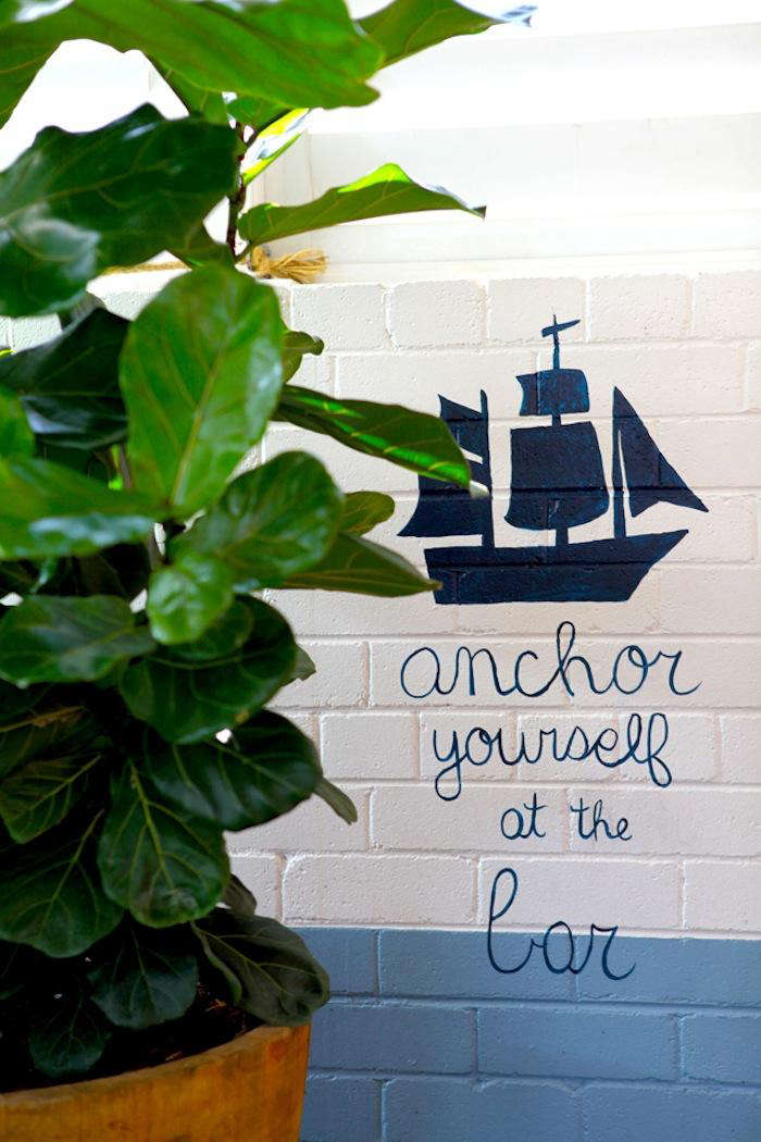 playful writing on a white and blue painted brick wall. 11