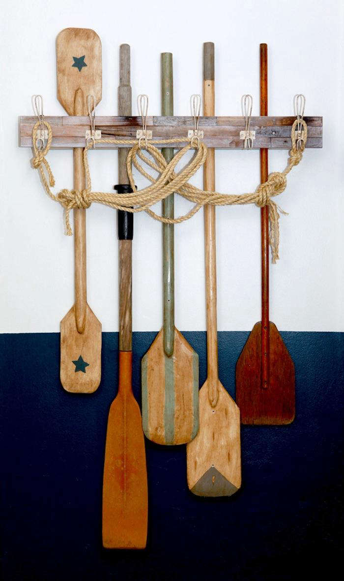 nautical accents such as wooden paddles can be found throughout the space. 13