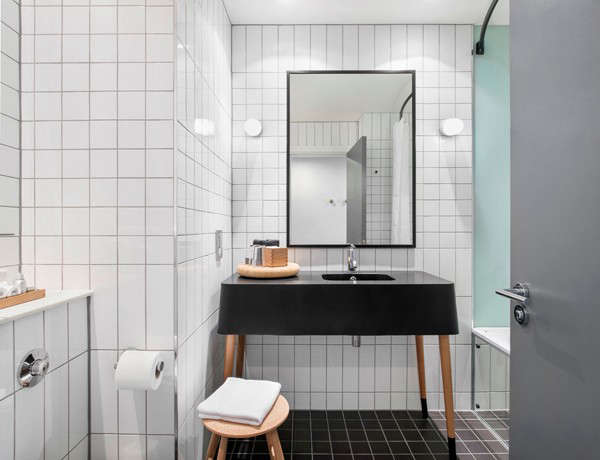 ace hotel black bath remodelista