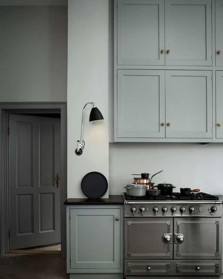 blue gray kitchen black sconce