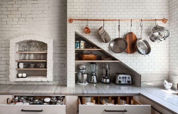A kitchen in Boston byBunker Workshopwith a copper storage rail. Photograph courtesy of Bunker Workshop, a member of the Remodelista Architect/Designer Directory.