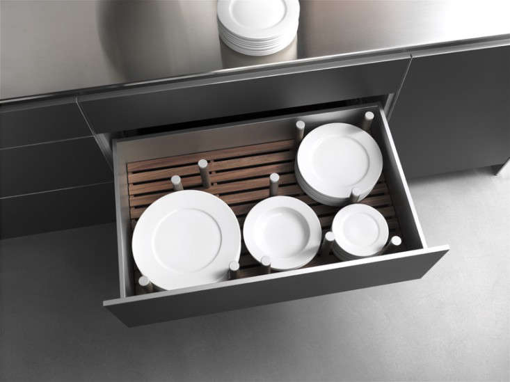 A deep drawer with pegs for plate storage from German company Bulthaup.