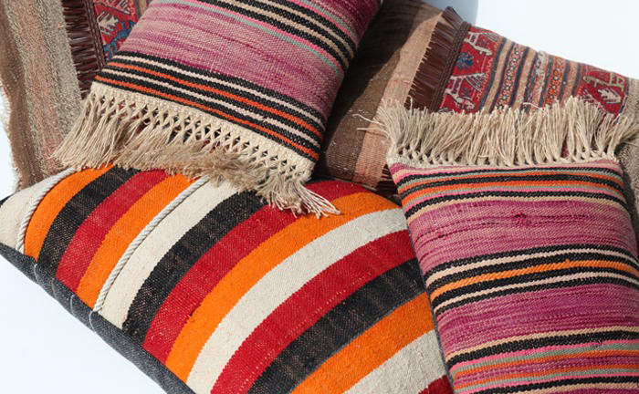 commune colorful striped pillows remodelista