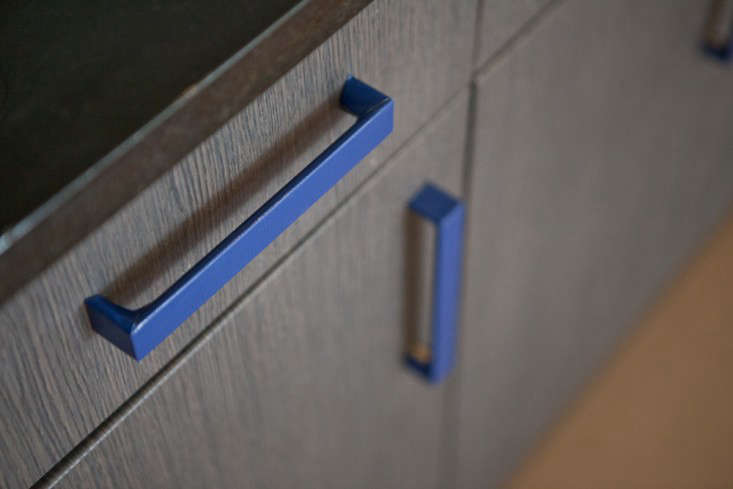 Or, wrap cabinet pulls in tape (these, inRental Rehab: The DIY New York Apartment, are wrapped intextured blue duct tape cut with an X-Acto knife); rope or cloth could also work.
