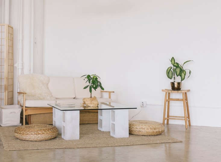the modern go to coffee table is the cinder block and glass top combination (mo 16