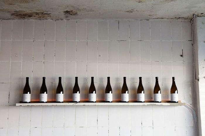 fiskbars tiled wall wine bottles