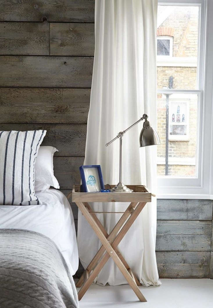 Wood treated with vinegar and steel wool takes on a weathered, silvery-gray cast, similar to the paneled headboard here. See House Call: Endless Summer in a London Victorian. Photograph courtesy of Light Locations.