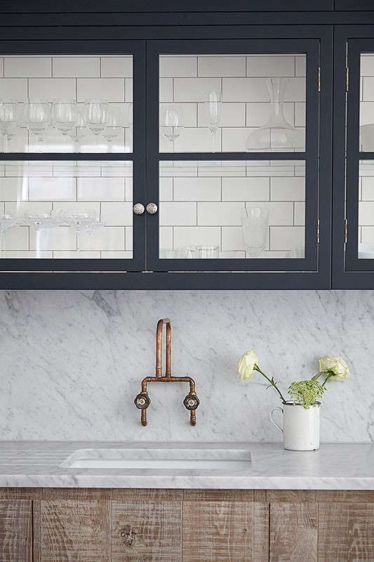 In a kitchen by London designer Jamie Blake, the cabinet interiors are tiled; see more at Steal This Look: The Endless Summer Kitchen.