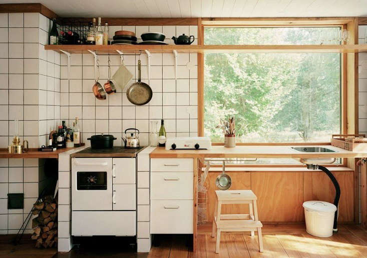 An airy cooking space in Scandinavian Simplicity: A Reimagined Swedish Summerhouse.