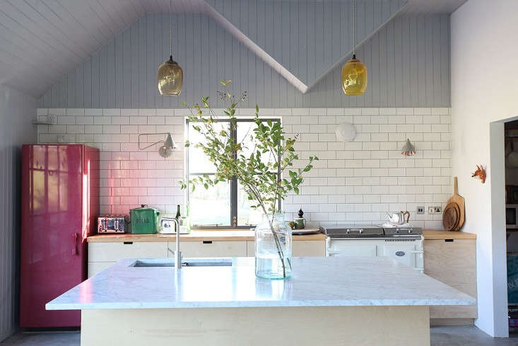 an unexpected twist in a serene plywood kitchen: a look at me raspberry colored 17