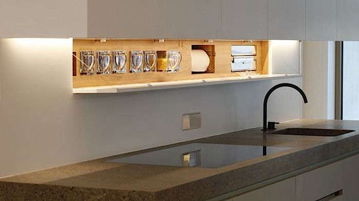 Above: A recessed storage area offers space for paper towels and storage drawers in a German kitchen by Holzrausch.