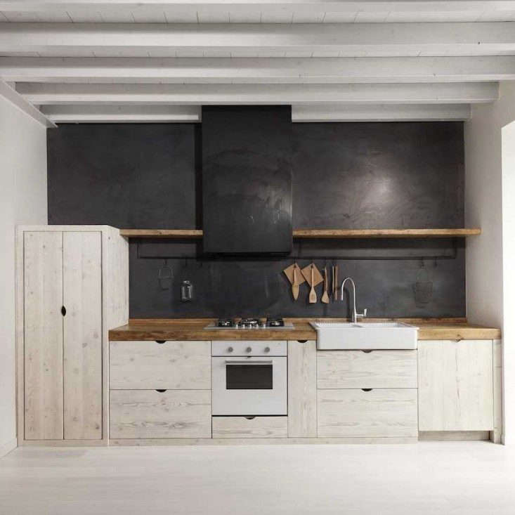 A German-born designer builds a sleek kitchen of salvaged wood and blackened sheet metal in an apartment in Bergamo. Read more atKitchen of the Week: The New Italian Country Kitchen by Katrin Arens, Scrap Wood Edition.