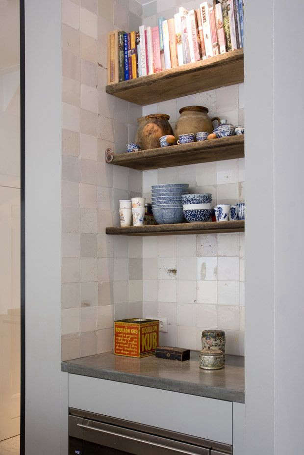 Handcut tiles frame a display nook inKitchen of the Week: Arjan Lodder Keukens Kitchen in the Netherlands.