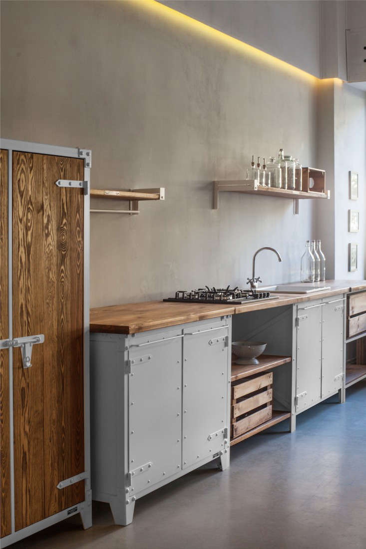 The kitchen cabinets are made of steel with pine countertops. They&#8