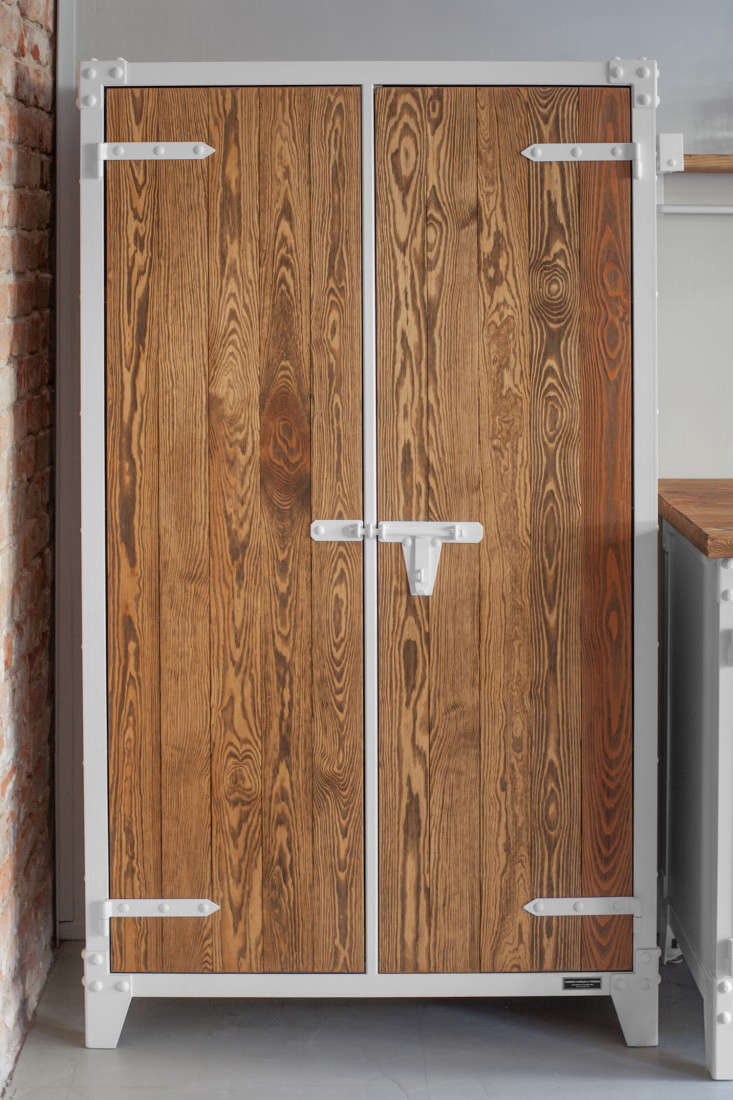 The steel-framed double-door pantry is fitted with three wood shelves. The Wooden Cabinetstarts at€