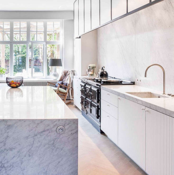 An integrated Carrara marble sink in a kitchen by Belgian company Obumex.