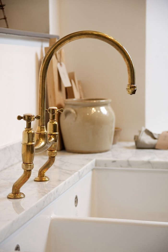 the perfectly aged brass kitchen faucet