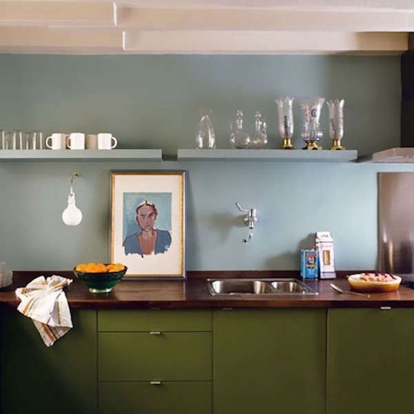 a kitchen in paris by architectphilippe harden, a portrait propped on the woo 18