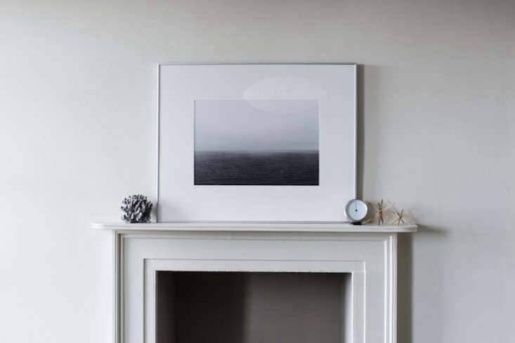 a photo by stapleton (inspired by hiroshi sugimoto) rests on the mantel. staple 13