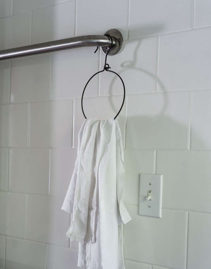 a fog linen wire hanger on the towel bar. 10