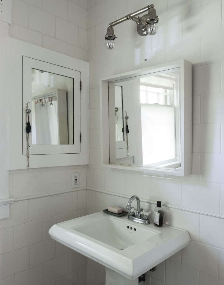 An ornate wooden mirror originally hung over the sink. I replaced it with the Molger Mirror in birch from Ikea. (The Molger Mirror is no longer available at Ikea but a similar style is the brand&#8