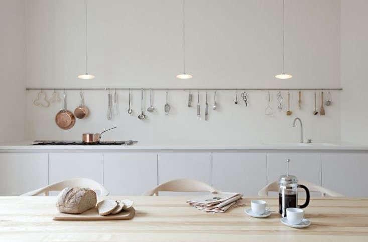 a kitchen length storage rail in a project by uk studio sevil peachfrom sevil 9