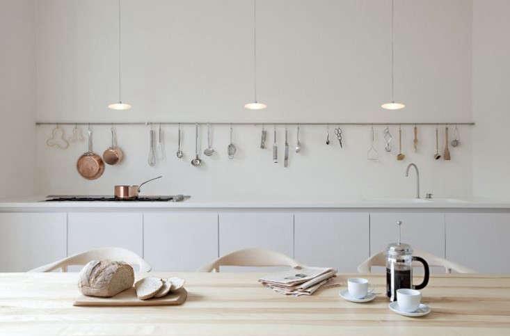 A kitchen-length storage rail in a project by UK studio Sevil Peachfrom Sevil Peach Studio in Primrose Hill.